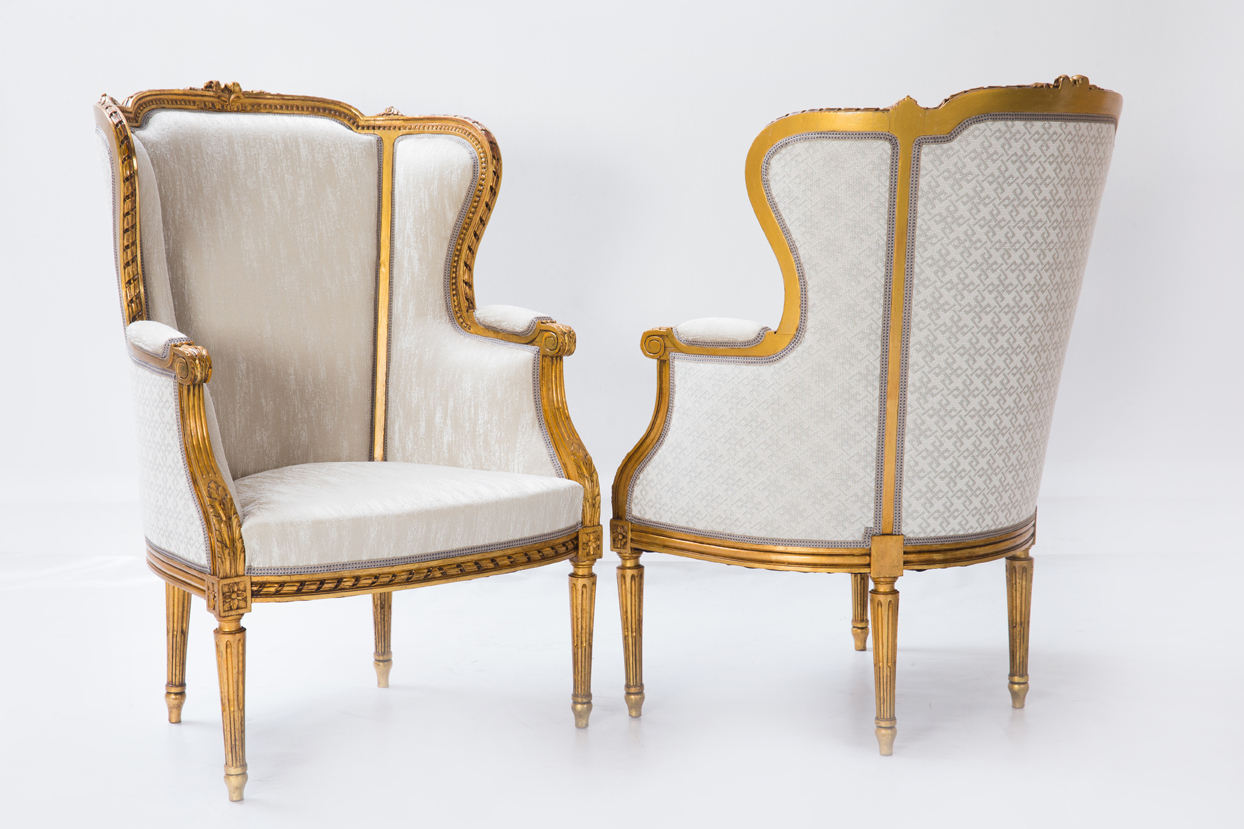 pair decorated armchairs